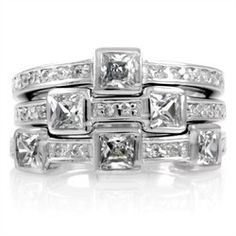 Enjoy the many different looks you can get out of this fun three ring set featuring sterling silver bands with bezel set princess cut CZs. Stack this geometric wonder on a single finger, wear one at a time, or sling them onto a necklace for a fashionable twist. The rings are rhodium electroplated and the princess cut stones are approx. .3 carats each.