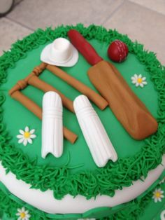 Fondant cricket bat, ball, wickets, hat and shin pads