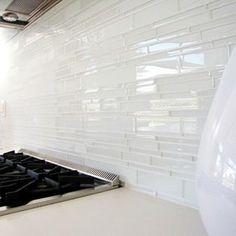 white glass tile backsplash Kitchen Midcentury with backsplash glass backsplash Glass Kitchen Splashback Tiles, Grey Backsplash, Glass Tile Backsplash, Backsplash Ideas, Kitchen Countertops, Kitchen Cabinets, Grey Countertops, Tile Ideas, Tile Grout