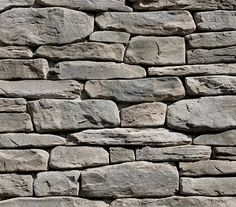 Exterior and Great Room Fireplace Stone with stained mantel above and white enameled cabinets on both sides Stone Masonry, Stone Veneer, Brick And Stone, Grey Stone, Faux Stone Walls, Textured Walls, Textured Background, Stone Stairs, Grey Exterior