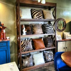 Cowhide pillows display in our beautiful  #HoustonTexas shop store in the Heights.