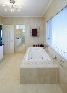Choose Beaumonts for stunning tiles & bathroom products to suit all styles & budgets. From bathrooms to whole home renovations, make your dream a reality. Romantic Bathrooms, Beaumont Tiles, Towel Rail, White Walls, Corner Bathtub, Tile Floor, Family Room, Flooring, Travertine