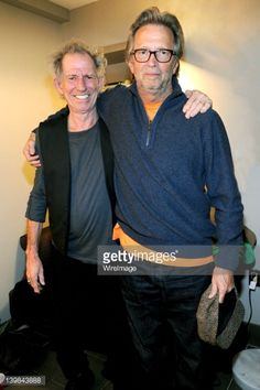 Keith Richards and Eric Clapton backstage during Howlin For Hubert: A Concert to Benefit the Jazz Foundation of America at The Apollo Theater on February 24, 2012 in New York City.