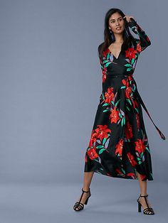 Cut in 100% woven printed silk satin, this long-sleeve, midi-length wrap dress features our custom Argos floral print in black, a V-neck, and a classic wrap-style closure.
