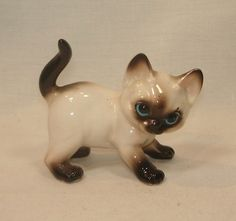 JOSEF ORIGINALS Porcelain Playful Siamese Kitty CAT Figurine This cat measures approximately 3 inches long and about 2 3/4 inches tall to the top of its tail.  It is made of porcelain by Josef, in Japan.  The original Josef label is still attached to the underside 25.95