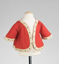 1855-1865 American Child's wool jacket at the Metropolitan Museum of Art, New York - What's interesting about this piece is the white fabric trim that is meant to simulate ermine.  Historically, ermine has been associated with royalty and nobility, so it's interesting to see it being imitated on a child's garment.