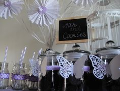 Milk and cookies bar for sleepover birthday party. Butterfly theme purple and white.