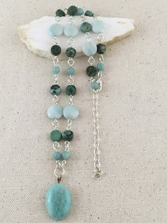 Turquoise Amazonite Pendant Necklace on Beaded Strand of Amazonite and African Turquoise  Beads and Silver $85 USD Only 1 available  #turquoisenecklace #silverandturquoise #amazonitenecklace #pendantnecklace #statementnecklace