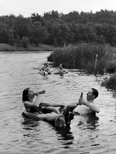 Couples floating down the Apple River while drinking beer in Somerset, WI 1941 // Alfred Eisenstaedt