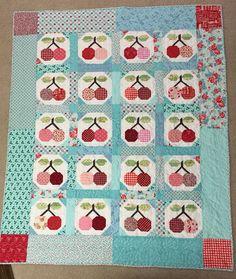 Farm vintage cherry quilt. Live the Reds and aquas.