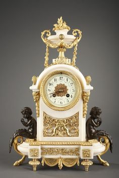 A very beautiful Louis XVI style mantel clock in marble  with rich gilt bronze decoration, surmounted by a vase with fruits and foliage, provided with scrolled handles supporting garlands. T