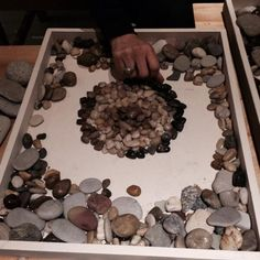 """Stones to explore in a tray, at the Hawkins 'Messing about' workshop - image shared by Simone Spiegel (msspgl on Twitter) ("""",)"""
