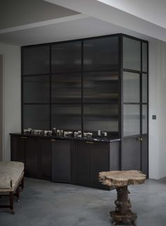 The concealed larder (with hidden full-size fridge) in Plain-English's Mapesbury Estate kitchen | Remodelista