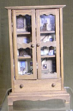 Cabin in a Cabinet Micro Dollhouse, a 1/12 scale inexpensive doll house display cabinet with a cabin dollhouse in 1:144 scale built inside.