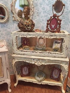 Miniature Jewelry cabinet = Shabby Chic Jewelry Cabinet.1:12 scale miniature.All 14 pieces in cabinet and on cabinet are included.Cabinet is 4 inches tall and 3 1/4 wide. Perfect for shop / Bridal /Ladies Boutique . Z