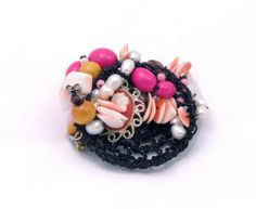 """Cameo"""" brooch (below) by Regina Middleton is made of an assortment of materials like electrical wire, shell, coral, cameo, pearls (both fake and real). Middleton is an 'ethical' jewelry who routinely uses cast off items in her work"""