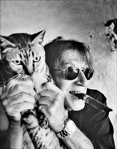 Jacques Dutronc & one of his 40 cats. French singer, songwriter, guitarist, composer, and actor. by Patrick Swirc