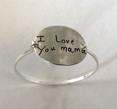Bracelet engraved with your kid's actual writing or a picture they've drawn. // Someone get me the tissues! This would be the most amazing gift for me!!!  More husbands should be on Pinterest so they can see this!!!