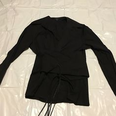 Gucci black long sleeved top Black top is long sleeved with collar neckline. Cumberbund wraps around waist with braided tie. Made in Italy - size 40 Gucci Tops