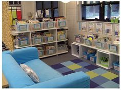 Beautiful classroom library.  Love the bins for organization; maybe color coded by genre or theme