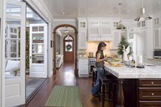 """Love big folding doors and wood trim around interior door. Would love to have """"u"""" shaped home with courtyard and these folding doors along each wall Brown Kitchens, Home Kitchens, Farmhouse Kitchens, Style At Home, Comedor Office, Midcentury Modern, Interior Exterior, Interior Design, Enchanted Home"""