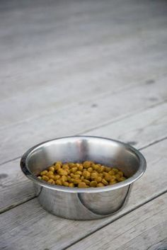 Making dog kibble at home is simple -- mix a basic dough with your dogs favorite foods to create a crunchy meal. Keeping harmful additives and preservatives out of his food benefits his health, and making dry food from fresh ingredients can be less expensive than purchasing a commercial brand.