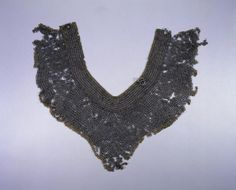 Collar, 15th century European, 15th century riveted steel rings, Diameter - w:0.50 cm (w:3/16 inches) Overall - w:61.50 l:25.70 cm (w:24 3/16 l:10 1/16 inches) Wt: .92 kg