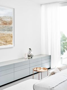 A beautiful redesign of a small narrow area in a Melbourne Victorian Terrace house … the calming white, shades of grey & pastels, soft sheer curtains & well chosen furnishings, all add to make this a tranquil retreat removed from the bustle of the main house. Design by Fiona Lynch, photos by Brooke Holm with styling by Marsha Golemac. x debra …