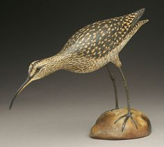 A rare decorative feeding curlew by Elmer Crowell went over estimate at $109,000.