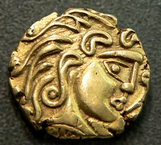 """100-50 BCE. Gold coin of the Parisii tribe of ancient Gaul found in the Île-de-France. The Parisii were a Celtic Iron Age people that lived on the banks of the river Seine from the middle of the 3rd C. BCE until the Roman era. """"Paris"""" is derived from these Celts. The face derives from Greek sources, but the Celtic aesthetic toward distinct stylized abstract shapes is beautifully evident here. Cabinet des Médailles, France,"""