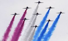 """""""Spectacular: RAF Hawk training aircraft perform a flypast, creating the colours of the Union flag"""""""
