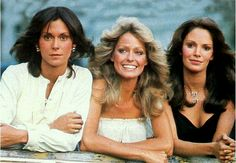 Farrah smiles with her new friends and co-stars: (l) Kate Jackson and (r) Jaclyn Smith, 1976.