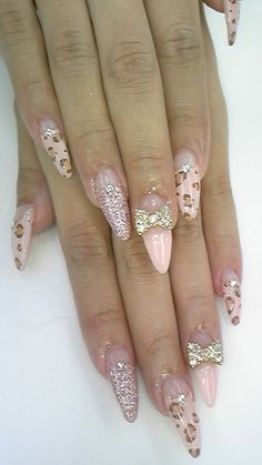 soft pink leopard stiletto nails