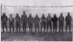 Football team of British soldiers with gas masks, Western front, 1916.