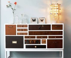 Thinking about doing this to an old dresser....white base, different color stain (or paint) for each drawer and a mix of different handles....