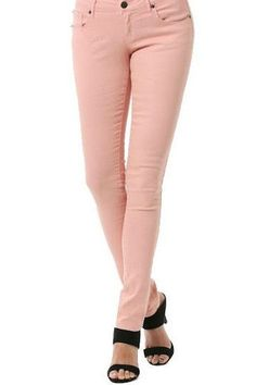 """ThesePink Skinny Jeans are pretty and feminine, as well as versatile! They can go with almost any type of top. You will feel so sassy in these pants! 98% Cotton 2% Spandex Inseam: 31"""""""" Sizing Chart 24"""
