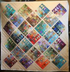 Geese Migration quilt with scrappy flying geese and patches.   Quilted by Ideal Stitches. The pattern is by Cynthia Brunz of Quilting is More Fun than Housework. Free download at Sew Mama Sew: http://www.sewmamasew.com/2015/06/geese-migration-quilt-tutorial-from-dear-quilty-giveaway/