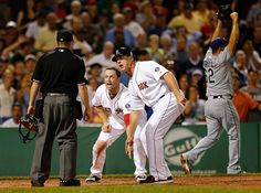 Jim Rogash / Getty Images Pinch runner Daniel Nava (without cap) and third base coach Brian Butterfield of the Boston Red Sox plead their case after umpire Jerry Meals called Nava out at the plate against the Tampa Bay Rays in the eighth inning at Fenway Park on July 29 in Boston, Mass. Nava's run would have tied the game.