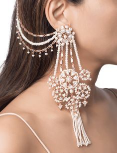 The heritage sahara earrings are handcrafted in base metal with 22 kt gold plating and feature an ornate arrangement of Swarovski cubic zirconia crystals and tiny luminous pearls. Pearl tassels and a layered sahara that hooks onto your hair add a unique a Indian Jewelry Earrings, Indian Jewelry Sets, Jewelry Design Earrings, Ear Jewelry, Bridal Jewelry Sets, Wedding Jewelry, Statement Jewelry, Gold Jewelry, Silver Earrings