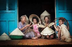 Vietnam Long An - The moments Photo by Huynh Jet — National Geographic Your Shot - a family producting Palm-leaf conical hat at Long An, Vietnam