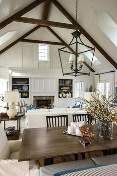 HGTV Dream Home 2015 - Dining Room View Into Great Room. Love the bookcase and doors to hide the tv over the fireplace.