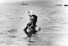 Dizzy Gillespie ... personal pic obviously taken by a friend of Dizzy blowing horn while standing in the ocean.  Too cool!