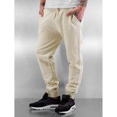 Shop online Bangastic Men's Sweat Pant Thailan in beige from CompleX. cozy sweatpantsdrawstring outside of the elastic waistband for excellent gripside pockets with cuddly liningsoft fleece fabric for comfortribbed leg cuffs for a perfect fitregular fi Mens Fashion Online, Online Fashion Stores, Men's Fashion, Mens Sweatpants, Men's Pants, Leg Cuffs, Fleece Fabric, Parachute Pants, Beige