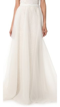 Layers of tulle float over this silk-organza maxi skirt, creating ethereal movement, while delicate beading details the waist. Hook-and-eye closure. Fully lined.