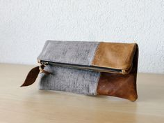 Leather Clutch in Brown Cow Leather and European Washed Linen with Herringbone Pattern - Indie Patchwork Series. $69.00, via Etsy.