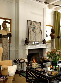 A 19th-century marble mantelpiece adds to the sophisticated but bohemian ambience of this Michele Bönan–designed sitting room (photo courtesy of Michele Bönan)