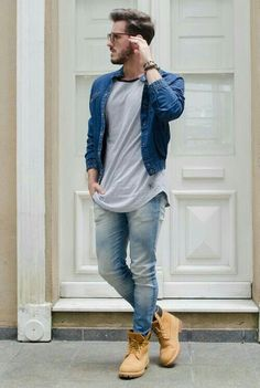 distressed jeans, a grey t shirt, a blue denim jacket and yellow boots