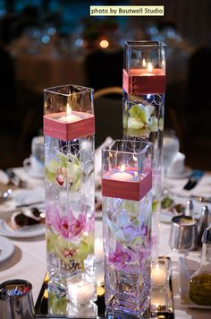 BEAUTIFUL centerpiece idea. Floating candles and submerged flowers.