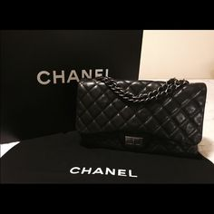 "AUTHENTIC CHANEL JUMBO REISSUE FLAP BAG 277 10000% Authentic or your money back. Chanel 2.55 Single Flap Bag 277 size. Mademoiselle lock, ruthenium silver hardware, interwoven leather straps, black calfskin leather. 2011/2012 season. Approximately 12″ x 7.5″ x 3 ¾"". Comes with box and dust bag. Great condition. Retails $6000 plus tax. Own a real Chanel for a fraction of what I paid. I will cover shipping fees to cover expedited shipping, full insurance, signature, and tracking. I accept…"