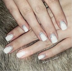 This sparkly winter nail look was created with our #whitelily & #silverglitter gel colors.